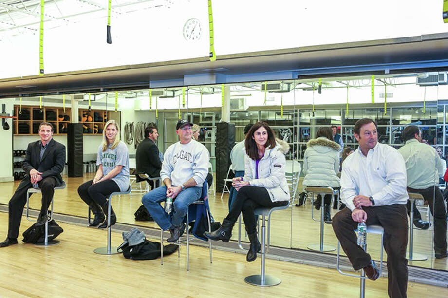 Equinox Darien and Competitive Edge recently hosted a panel with  athletes and coaches addressing the myths and realities of the college recruiting process. From left, Eric Pellini, assistant track coach at New Canaan High School; Kevin Rusch, owner of Competitive Edge; Courtney Bennett, former Darien High School lacrosse player; Marj Trifone; head girls swimming coach at Darien High School; Rob Trifone, head football coach at Darien High School. Photo: Contributed Photo, Contributed / New Canaan News Contributed