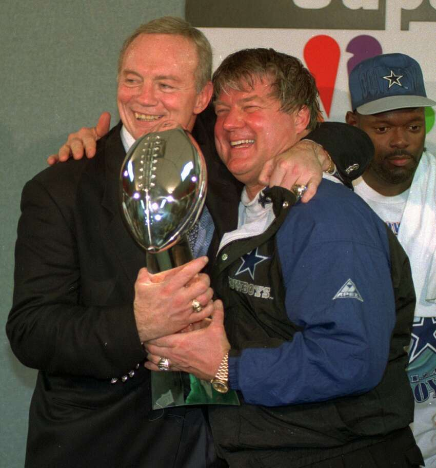 In this Jan. 30, 1994 file photo, Dallas Cowboys owner Jerry Jones, left, and coach Jimmy Johnson celebrate with the Vince Lombardi trophye fter defeating the Buffalo Bills 30-13 in Super Bowl XXVIII at the Georgia Dome in Atlanta. Johnson made 51 trades in his five years in Dallas,