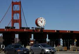 Vehicles pass through the tolls at the Golden Gate Bridge in San Francisco, Calif., on Monday, February 24, 2014.  Tolls may rise by $1 in April and another $1 over the next four years.