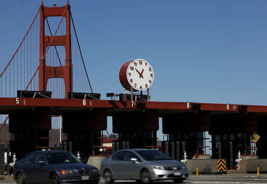 Vehicles pass through the tolls at the Golden Gate Bridge in San Francisco, Calif., on Monday, February 24, 2014.  Tolls may rise by $1 in April and another $1 over the next four years. Photo: Sarah Rice, Special To The Chronicle