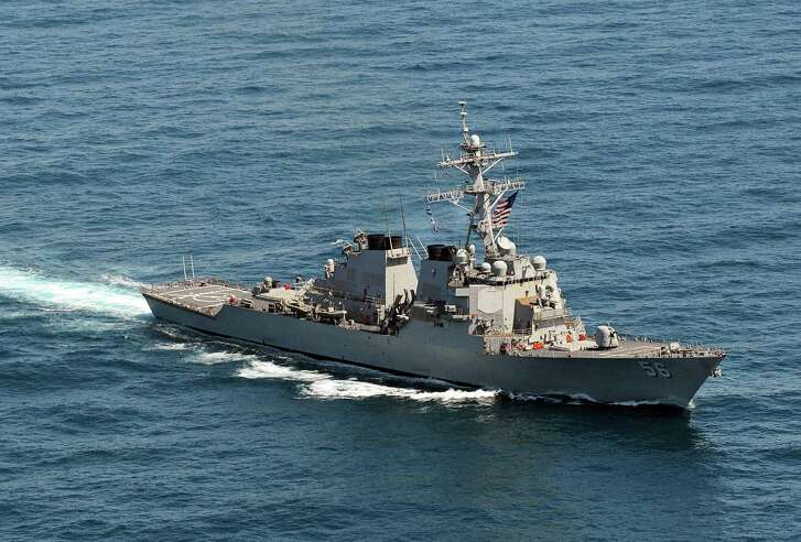 """This March 21, 2013 US Navy handout image shows the Arleigh Burke-class guided-missile destroyer USS John S. McCain (DDG 56) sailing in the waters off the Korean Peninsula during exercise Foal Eagle 2013.  McCain a member of Destroyer Squadron 15, forward deployed to Yokosuka, Japan, and is underway to conduct exercise Foal Eagle 2013 with allied nation Republic of Korea in support of regional security and stability of the Asia-Pacific region. AFP PHOTO/HANDOUT / US NAVY / MC3 Declan Barnes                           = RESTRICTED TO EDITORIAL USE - MANDATORY CREDIT """" AFP PHOTO / US Navy / MC3 Declan Barnes                           """" - NO MARKETING NO ADVERTISING CAMPAIGNS - DISTRIBUTED AS A SERVICE TO CLIENTS =HO/AFP/Getty Images"""
