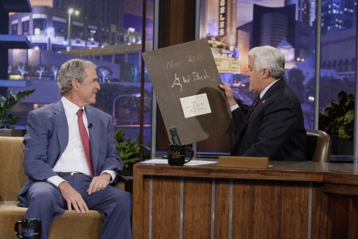 George W. Bush presented a portrait he painted of Jay Leno to the Tonight Show host Nov. 19, 2013.