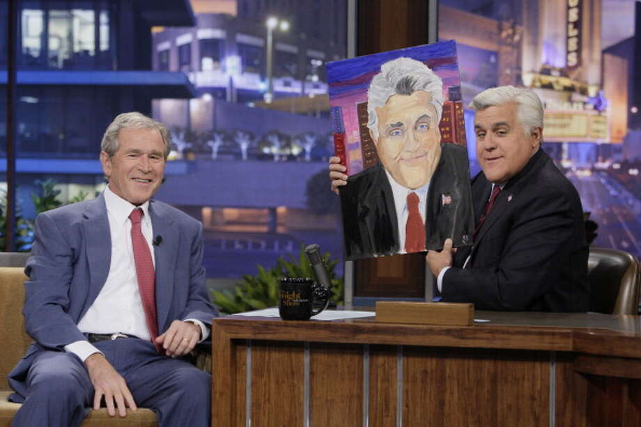 George W. Bush presented a portrait he painted of Jay Leno to the Tonight Show host Nov. 19, 2013. Photo: Getty Images / 2013 NBCUniversal Media, LLC