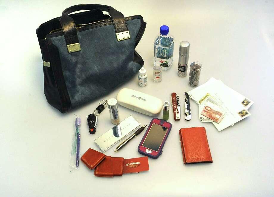 Tanji Patton'sbag includes business cards, an iPhone and wine keys. Photo: Billy Calzada, San Antonio Express-News / San Antonio Express-News