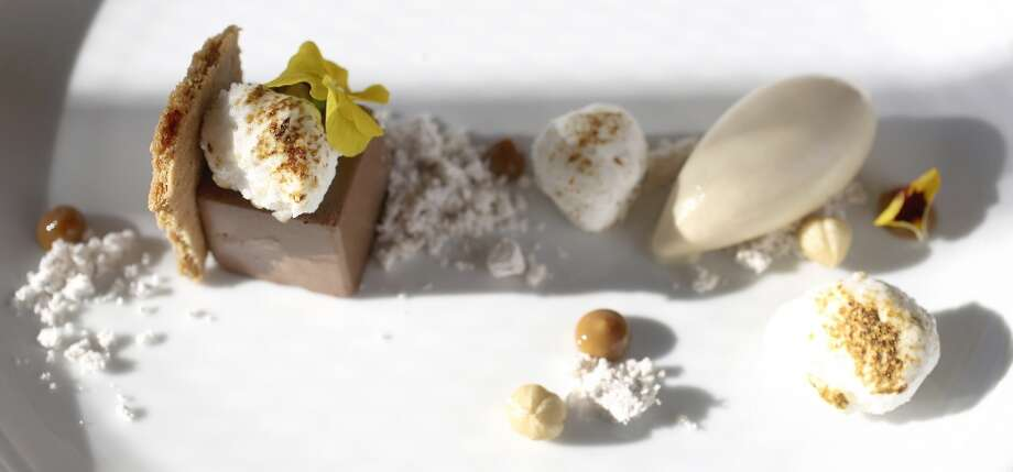 Milk chocolate mousse with speculoos, and roasted marshmallows, hazelnut powder and orange spree ice cream, one of the pastry creations at Triniti Restaurant by pastry chef Samantha Mendoza, Thursday, Oct. 17, 2013, in Houston. ( Karen Warren / Houston Chronicle ) Photo: Houston Chronicle