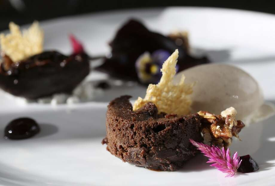 "Warm chocolate cake with currant gel ""sheet""; foie gras powder and brioche-infused gelato, a pastry creation by Samantha Mendoza, pastry chef at Triniti restaurant, Thursday, Oct. 17, 2013, in Houston. ( Karen Warren / Houston Chronicle ) Photo: Houston Chronicle"