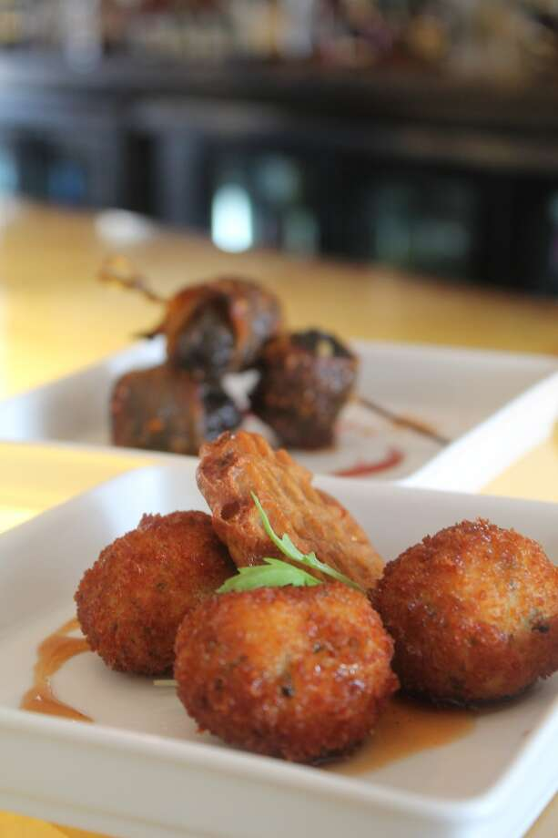 Fried Chicken Meatballs from a new bar bites menu at Triniti restaurant, Houston. Photo: Triniti