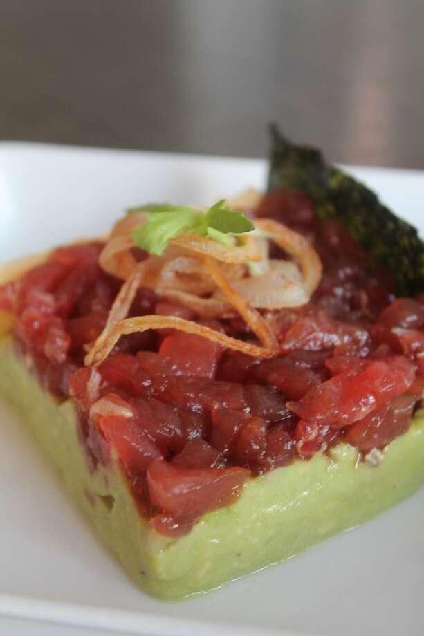 Tuna poke from a new bar bites menu at Triniti restaurant, Houston. Photo: Triniti