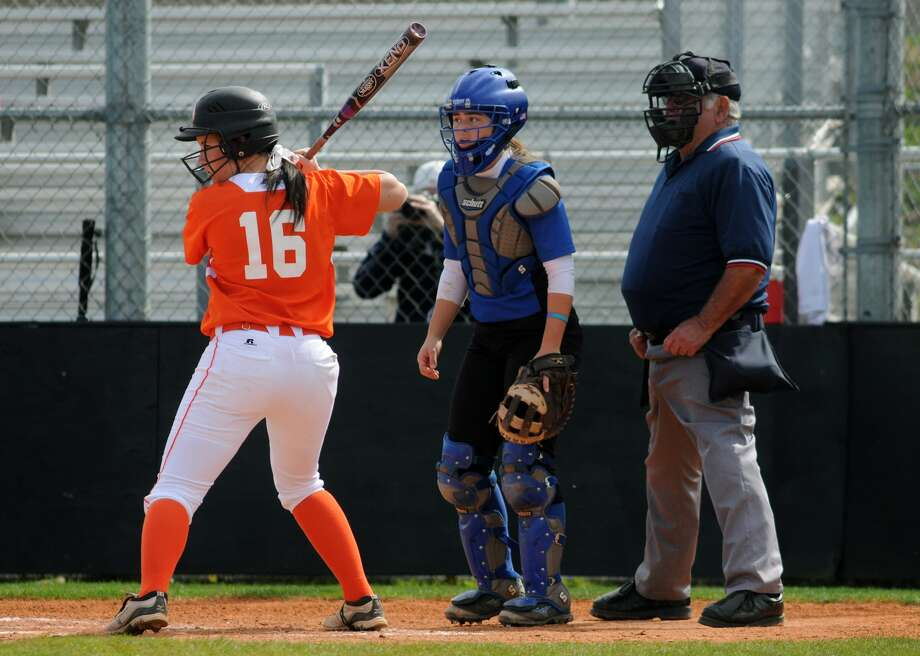Clear Springs catcher Dani Elder, center, leads the defense for the Lady Chargers. Elder already has pledged to Texas A&M. She is the only freshman who plays for the top team in the Impact Gold club program - arguably one of the top clubs in Texas. Photo: Jerry Baker, Freelance