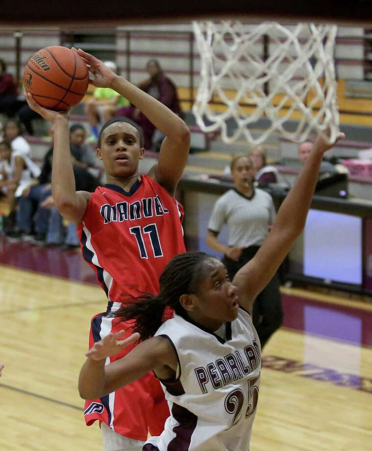 Manvel's Briana Turner (11) is averaging 21 points, 11 rebounds, four assists, three steals and four blocks. Photo: Thomas B. Shea / © 2014 Thomas B. Shea