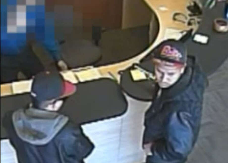 Two suspects are shown in a video supplied by Crime Stoppers