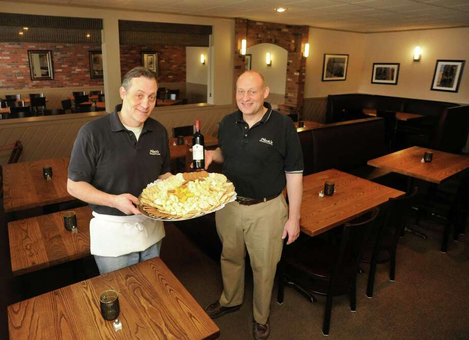 Brothers Frank and Victor DeGirolamo show off the new renovations at their business, Nick's Restaurant & Catering on Starr St. in Danbury, Conn. on Tuesday, Feb, 24, 2014. Photo: Cathy Zuraw / The News-Times