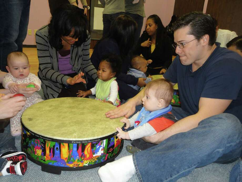 Joaquin Altenberg, right, with son Eytan participates in an exercise at the Prelude Music Classes for Children, located at 7901 Research Forest, Suite 400 in the Alden Bridge Center of The Woodlands. Photo: Ana Trevié±o-Godfrey