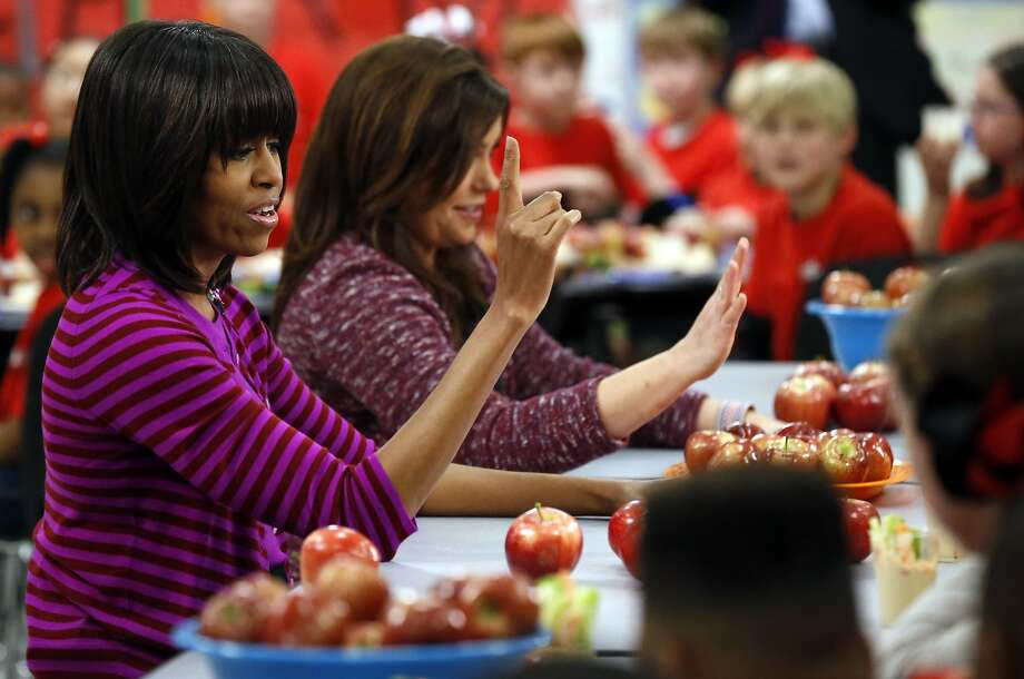 First lady Michelle Obama and Food Network chef Rachael Ray talk about lunches with students from the Eastside and Northside elementary schools in Clinton, Miss., last February. Photo: Rogelio V. Solis, Associated Press