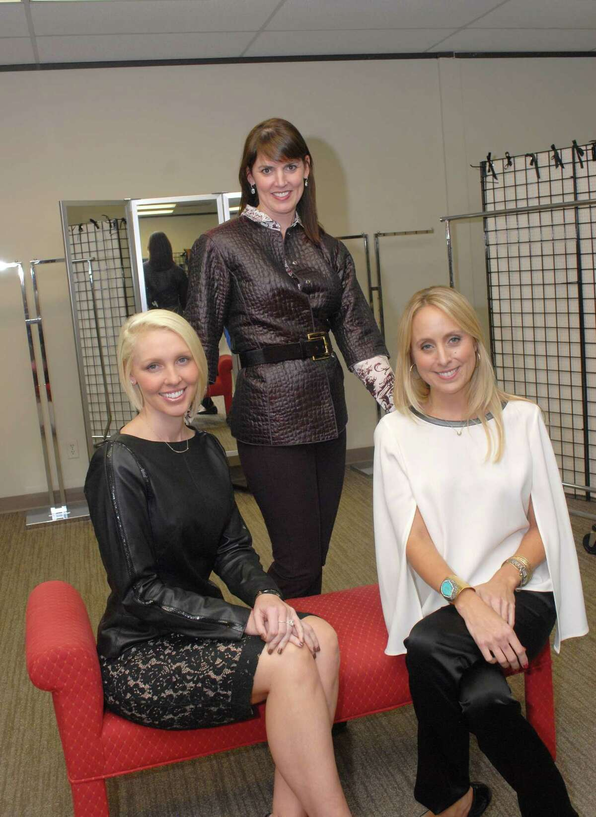 Wardrobe stylist, Rebecca Matthews,center, Natalie Daniels,left, and Emily Elliott,right, helps people enhance their wardrobes. They are personal style analysis, personal shopping, closet consultations and wardrobe planning in some of her company's services.