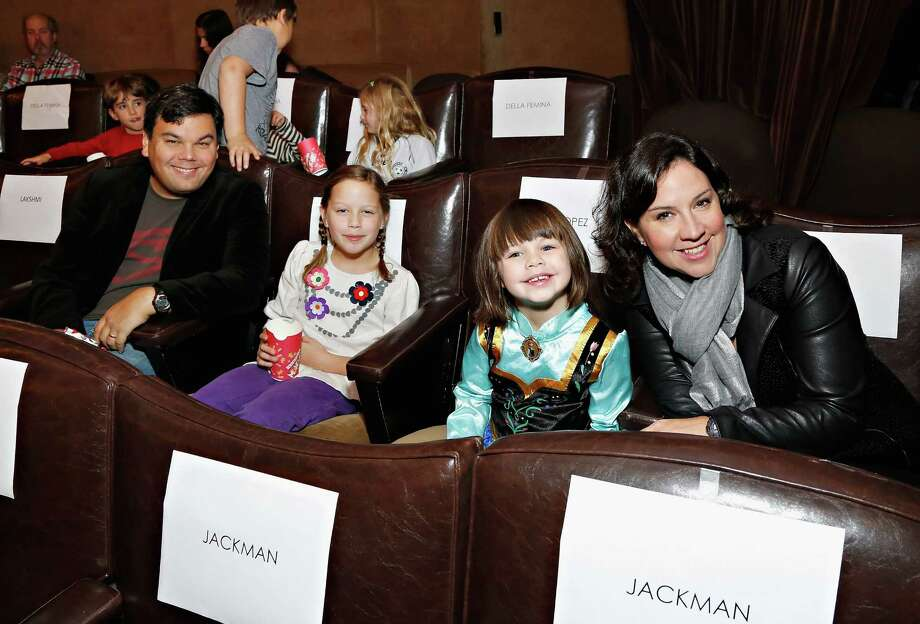 """Actor/writer/composer Robert Lopez, writer/lyricist Kristen Anderson-Lopez and their daughters attend a screening of """"Frozen."""" Photo: Cindy Ord, Stringer / 2013 Getty Images"""
