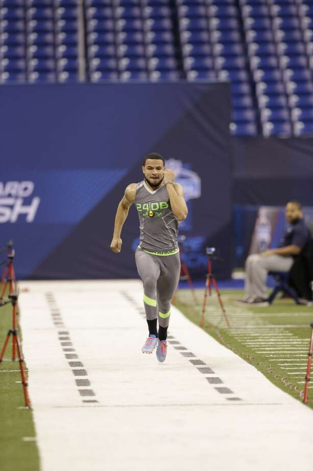 Rice defensive back Phillip Gaines runs the 40-yard dash at the NFL football scouting combine in Indianapolis on Tuesday. Photo: Nam Y. Huh, Associated Press