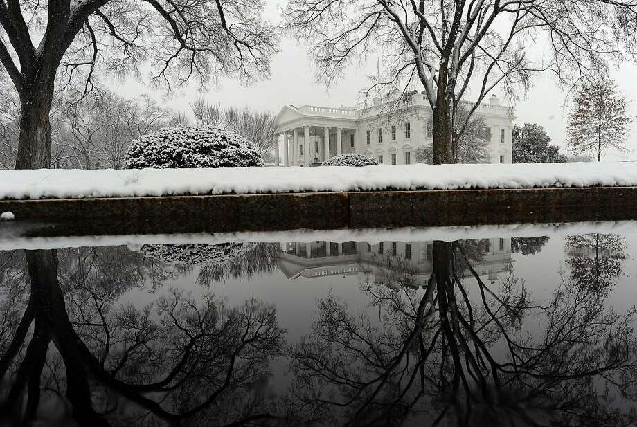 1600 Pennsylvania Avenue dusted: New snow covers the White House grounds in Washington. Photo: Jewel Samad, AFP/Getty Images