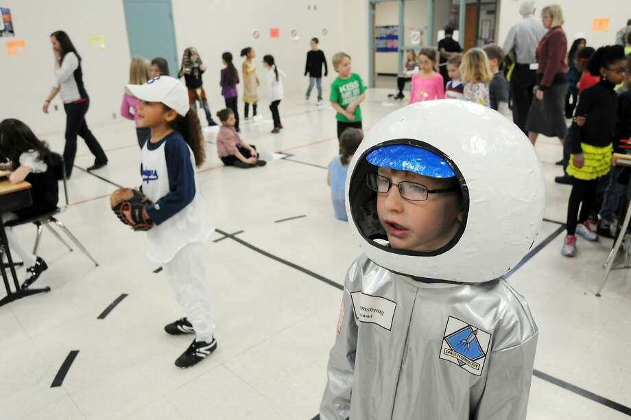 "That's one small step for boy, one giant step for boykind:Eight-year-old Jake Turner portrays astronaut Neil Armstrong during the ""Walk Through Time Wax Museum at Stewart Elementary School in Stevensville, Mich. Third-graders dressed as a variety of historical figures after researching information about their lives and accomplishments. Photo: Don Campbell, Associated Press"