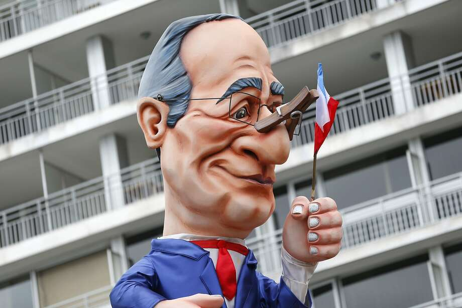 "Who cut the fromage? The ""Cheeses of Hollande"" float featuring French President Francois Hollande rolls down the street during the Nice Carnival in Nice, France. The theme of this year's carnival is the ""King of Gastronomy."" Photo: Valery Hache, AFP/Getty Images"