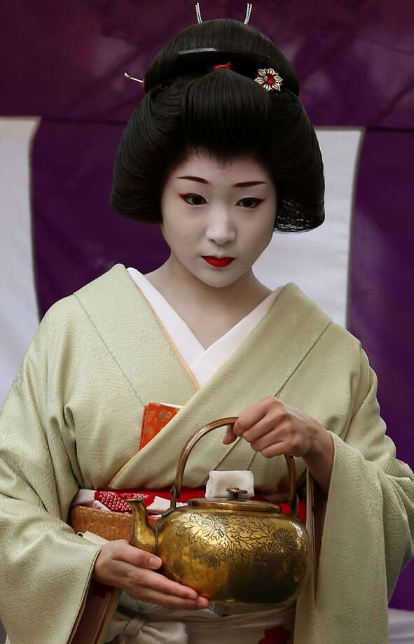 A geisha serves hot water to make green tea during the Baikasai Plum Blossom Festival at Kitano Tenmangu Shrine in Kyoto, Japan. The annual event commemorates enshrined Michizane Sugawara, a politician and plum-blossom aficionado of the Heian-Period, who died in 903. Photo: Buddhika Weerasinghe, Getty Images