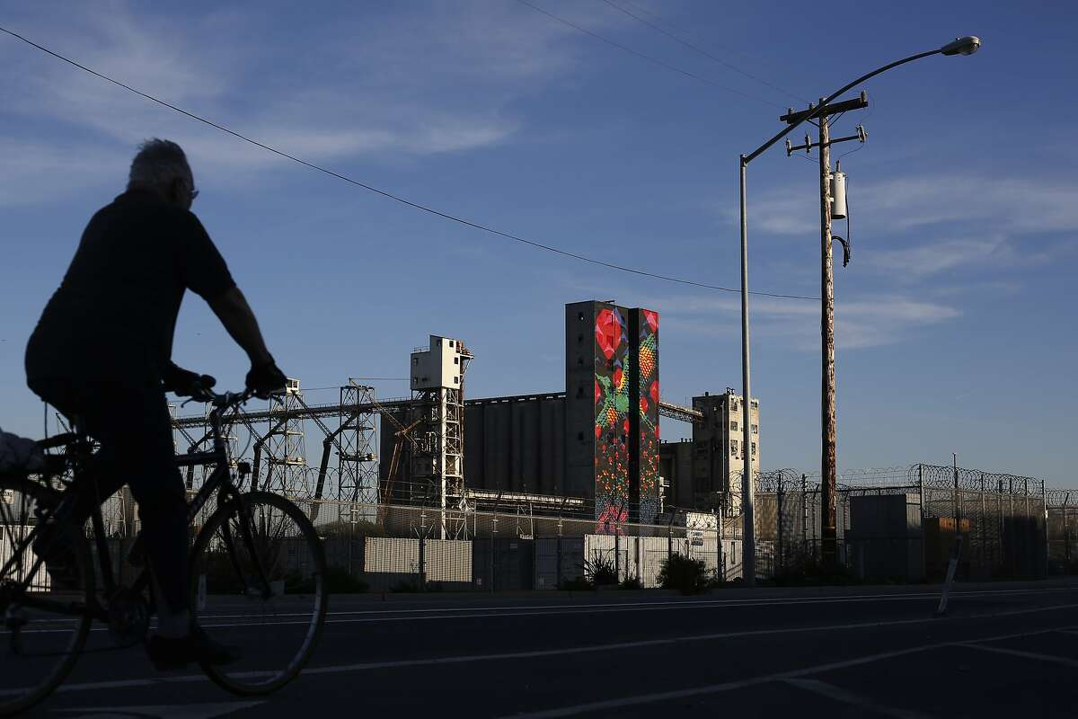 A matching set of painted silos at Pier 92 in the Dogpatch add color to an otherwise drab surroundings on Monday Feb. 24, 2014 in San Francisco, Calif.