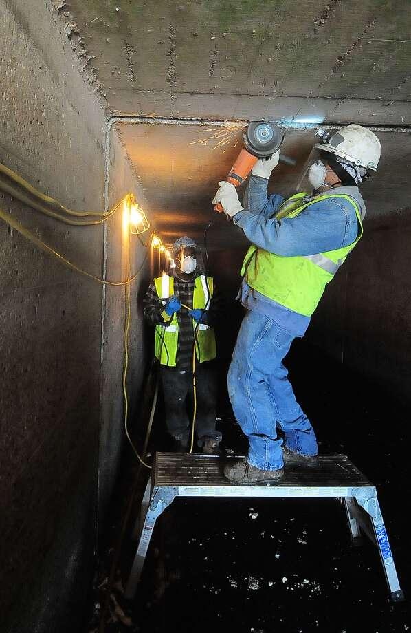 Roger Platt and Jose Hernandez of Epoxy Design make repairs to Barker Dam. Photo: Â Tony Bullard 2014, Freelance Photographer / © Tony Bullard & the Houston Chronicle