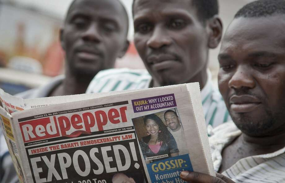 Ugandans in Kampala read the tabloid that outed many gays, including a hip-hop star and a priest. Photo: Rebecca Vassie, Associated Press
