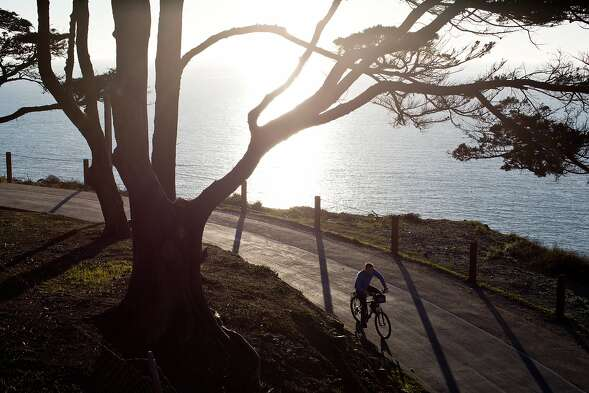 A cyclist rides on the bike path running under the Golden Gate Bridge coming from the west side bike lane in San Francisco, Calif., Monday, February 24, 2014