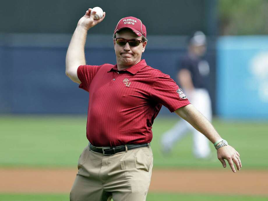 Florida State head football coach Jimbo Fisher throws out the ceremonial first pitch before a spring training exhibition game between Florida State and the New York Yankees Tuesday, Feb. 25, 2014, in Tampa, Fla. (AP Photo/Chris O'Meara) Photo: Chris O'Meara, Associated Press / AP