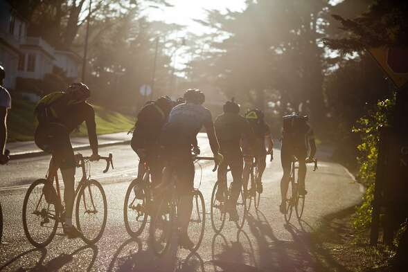 A group of cyclists ride up the Battery East Trail to the Golden Gate Bridge in San Francisco, Calif., Monday, February 24, 2014