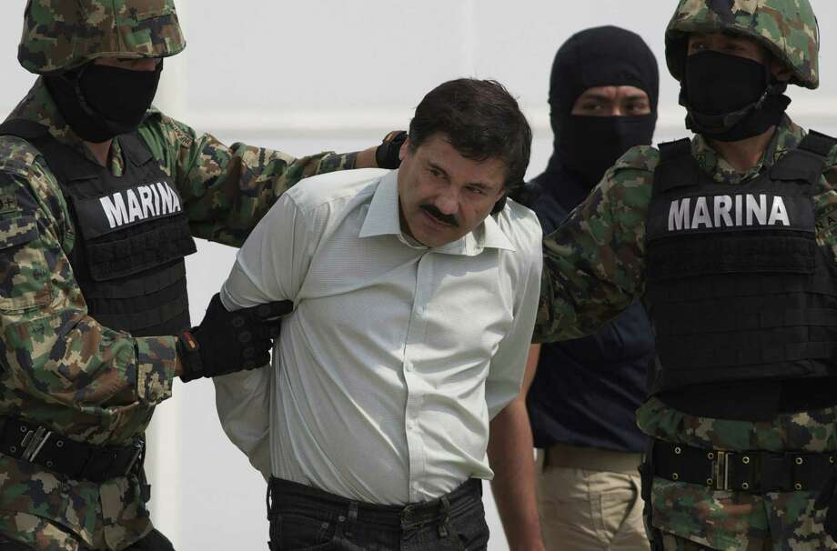 "Joaquin ""El Chapo"" Guzman is escorted to a helicopter in handcuffs by Mexican navy marines in Mexico City, Mexico, last week. His arrest signals a change of focus in the Mexican government. Photo: Eduardo Verdugo / Associated Press / AP"
