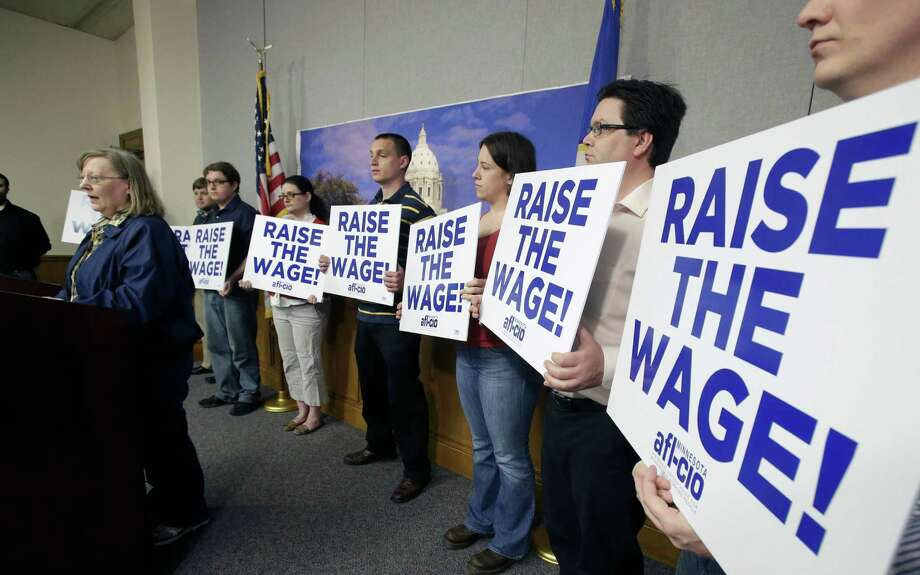 Supporters of a bill to raise Minnesota's minimum wage hold a news conference at the state Capitol in St. Paul last year. Minnesota's minimum wage is $6.15 per hour. Photo: Photos By Jim Mone / Associated Press File Photo / AP