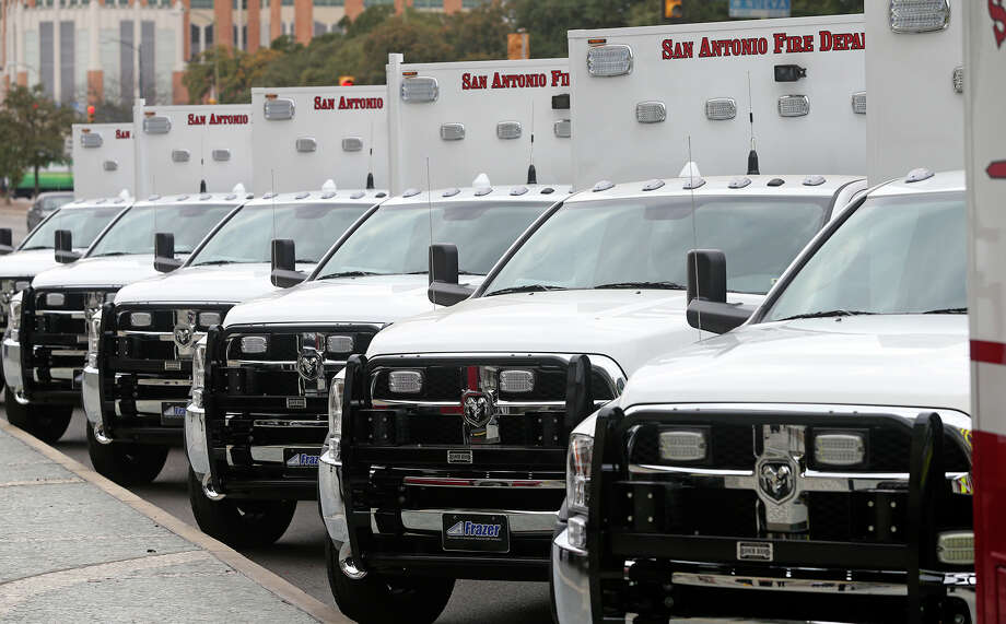 The SAFD unveils its new fleet of ambulances by rolling out 16 of the units at SAPD headquarters on February 25, 2014. Photo: TOM REEL