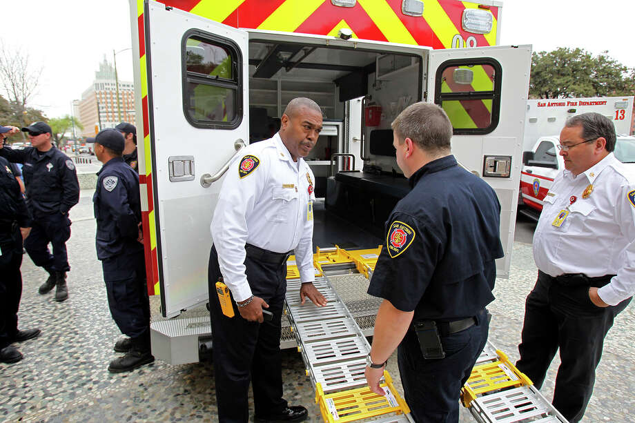 Fire chief Charles Hood checks out new style ramps as  SAFD unveils its new fleet of ambulances by rolling out 16 of the units at SAPD headquarters on February 25, 2014. Photo: TOM REEL