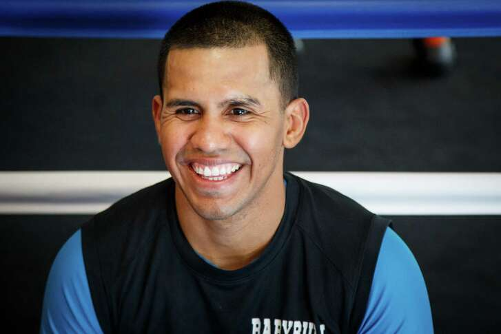 Four-time world boxing champion Juan Diaz of Houston addresses the media after the grand opening of the Baby Bull Boxing Academy, Saturday, Jan. 18, 2014, in Houston.  ( Michael Paulsen / Houston Chronicle )