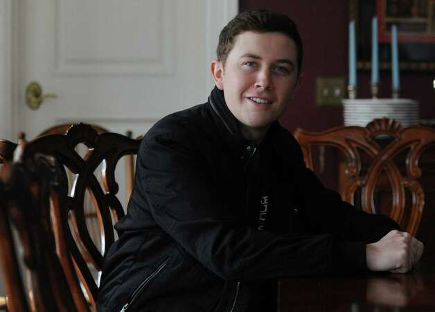 2011 American Idol winner and country music star Scotty McCreery poses at the Dana Holcombe House in Newtown, Conn. Tuesday, Feb. 25, 2014. McCreery, 20, has been selected to be the goodwill ambassador for the 12.14 Foundation in Newtown. Photo: Tyler Sizemore / The News-Times