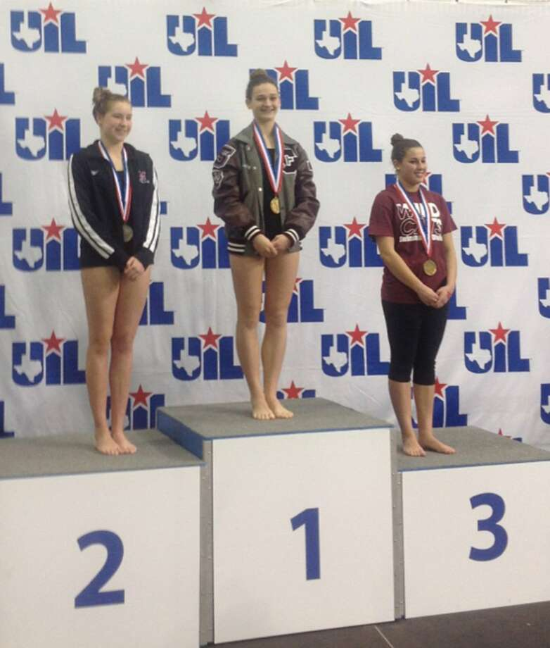 Cy-Fair High School junior Ashlynn Peters stands atop the medal stand after winning first place in the 1-meter diving competition at the UIL State Swimming and Diving Championships, held Feb. 21-22 in Austin. Photo: Courtesy Cy-Fair ISD / Handout