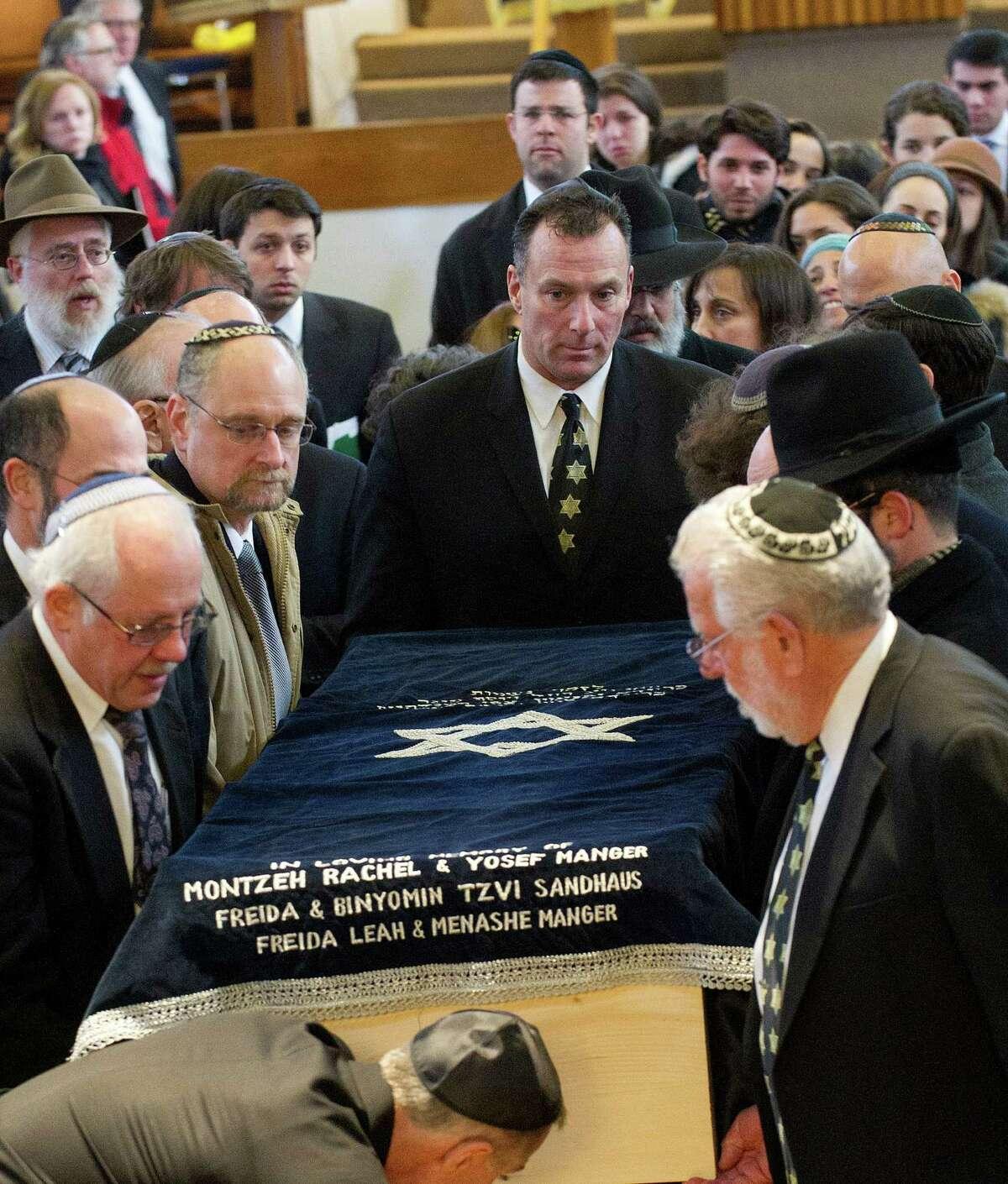 The recessional exits the funeral for Rabbi Joseph Ehrenkrantz at Agudath Shalom on Tuesday, February 25, 2014.