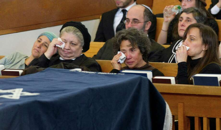 From left, daughters Bina Fendel and Doris Friedenberg, wife Sandra, and step-daugther Michelle Wolf attend the funeral of Rabbi Joseph Ehrenkrantz at Agudath Shalom on Tuesday, February 25, 2014. Photo: Lindsay Perry / Stamford Advocate