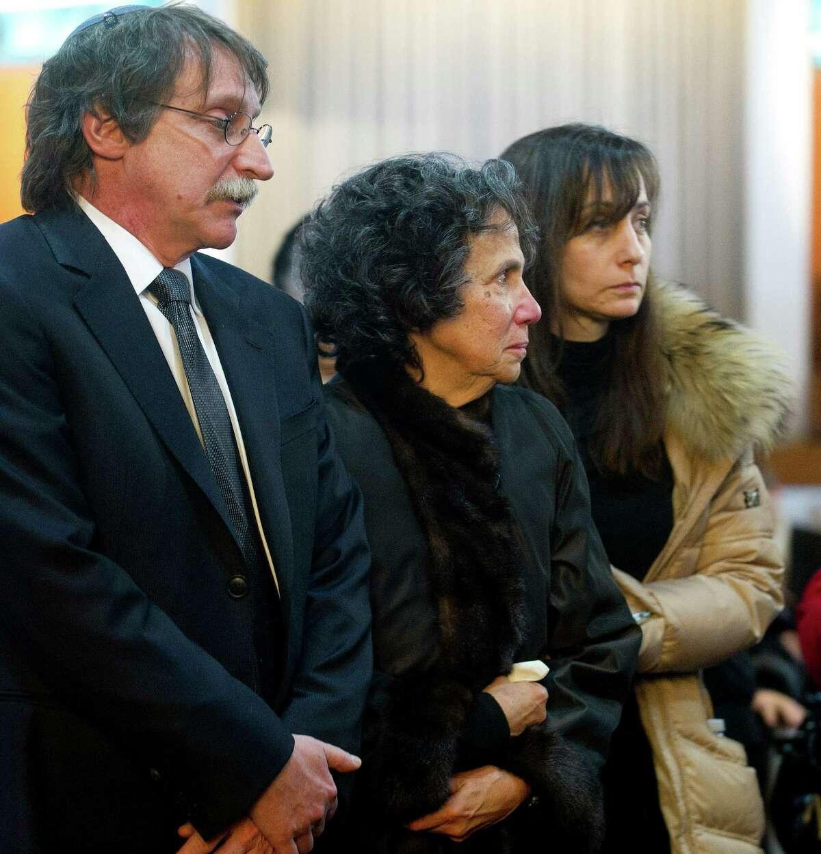 Sandra Ehrenkrantz, center, is accompanied in the recessional during the funeral for her husband, Rabbi Joseph Ehrenkrantz, at Agudath Shalom on Tuesday, February 25, 2014.