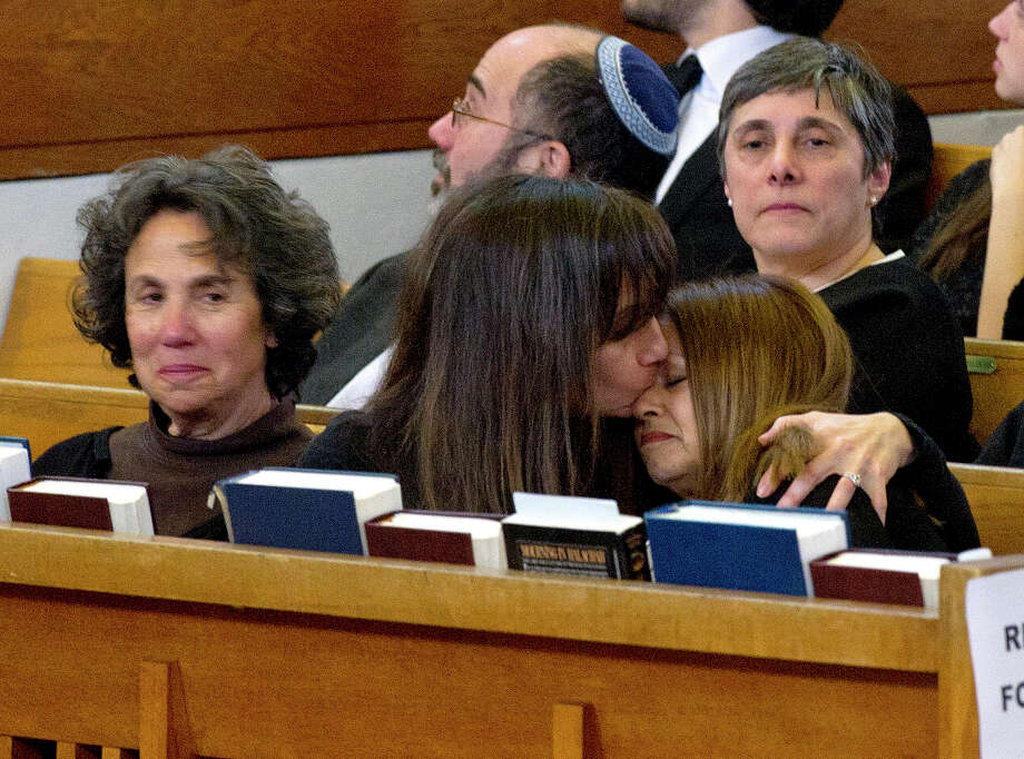 Step-daughter Michelle Wolfe, center, comforts Laura Ehrenkrantz after she gave a eulogy for her father, Rabbi Joseph Ehrenkrantz, at Agudath Shalom on Tuesday, February 25, 2014. Photo: Lindsay Perry / Stamford Advocate