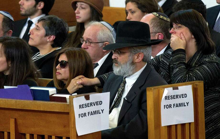 Family members, including children Laura and Bart Ehrenkrantz, attend the funeral for Rabbi Joseph Ehrenkrantz at Agudath Shalom on Tuesday, February 25, 2014. Photo: Lindsay Perry / Stamford Advocate