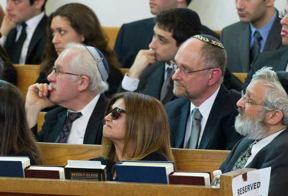 Mourners attend the funeral for Rabbi Joseph Ehrenkrantz at Agudath Shalom on Tuesday, February 25, 2014. Photo: Lindsay Perry / Stamford Advocate