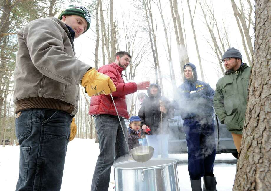 Matt Spinner of the Greenwich Land Trust, boils maple sap, collected from local trees, into maple syrup at the end of a Greenwich Land Trust winter nature walk at Duck Pond Hill, Greenwich, Conn., Tuesday, Feb. 25, 2014. Photo: Bob Luckey / Greenwich Time