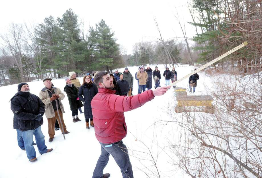 At right, Steve Conaway, stewardship & outreach manager for the Greenwich Land Trust, leads a winter nature walk at Duck Pond Hill, Greenwich, Conn., Tuesday, Feb. 25, 2014. Conaway spoke about how wildlife survives the winter and how to identify trees and plants without their leaves. Photo: Bob Luckey / Greenwich Time