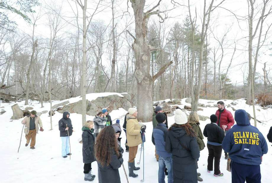 Steve Conaway, stewardship & outreach manager for the Greenwich Land Trust, leads a winter nature walk at Duck Pond Hill, Greenwich, Conn., Tuesday, Feb. 25, 2014. Conaway spoke about how wildlife survives the winter and how to identify trees and plants without their leaves. Photo: Bob Luckey / Greenwich Time