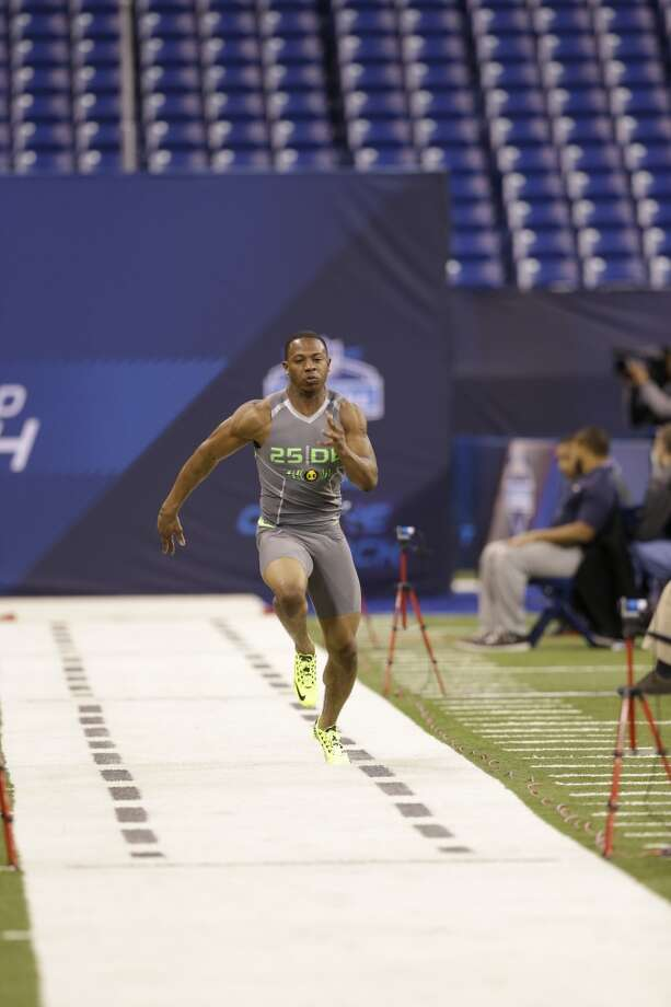 Oklahoma State defensive back Justin Gilbert runs the 40-yard dash. Photo: Nam Y. Huh, Associated Press