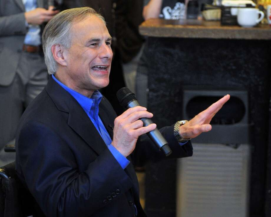 Attorney General Greg Abbott speaks to a group of supporters Tuesday, Feb. 18, 2014, during a campaign stop in his hometown of Wichita Falls, Texas. Abbott has been joined along the campaign by rocker Ted Nugent, an outspoken supporter of Second Amendment rights. Sen. Wendy Davis is Democratic opponent. (AP Photo/Wichita Falls Times Record News, Torin Halsey) Photo: Torin Halsey, Associated Press