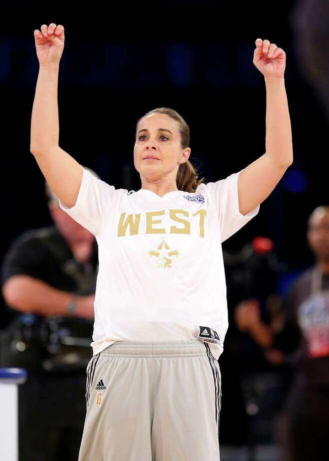 Western Conference WNBA All-Star Becky Hammon follows through on a shot during the 2014 NBA All-Star Weekend. A reader praised  the San Antonio player, as well as the Express-News for publishing an article about her. Photo: Ronald Martinez, Getty Images / 2014 Getty Images